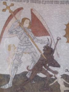 Details of the frescoes of the Romanesque church (St Michael slaying the devil)