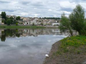 Castillon-la-Bataille is reflected in the Dordogne River