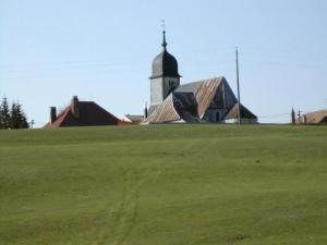 The church in summer seen from the Swin Golf