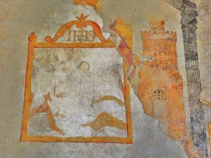 Mural painting in the church, perhaps representing the old castle (© Jean Espirat)