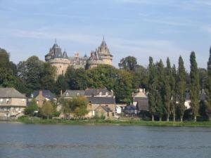 Castle Combourg and tranquil lake