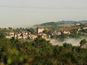 Village emerging from the mists of September