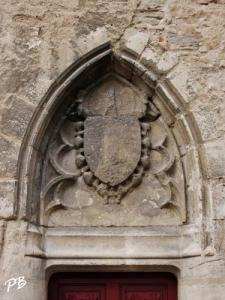 Gate of the old tower fortification: coat of arms kings of France surrounded the collar of the Order of Saint-Michel