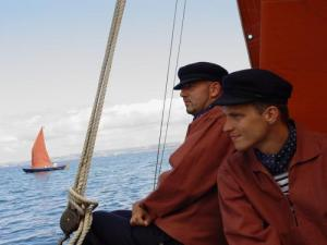 Etaples in traditional dress on an old sailing ship