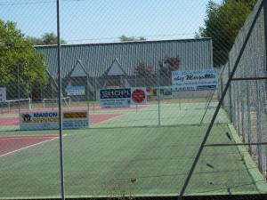 the 7 tennis courts including a covered