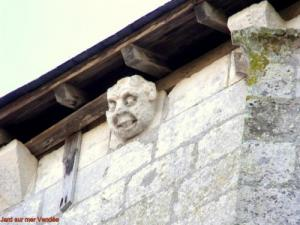 Statues of heads of monsters on the steeple