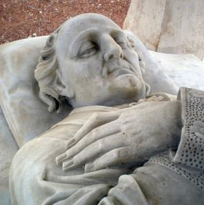 Detail of the tomb with marble lizard of the abbot Jacques Brun, priest-archpriest of Lugny, visible in the cemetery