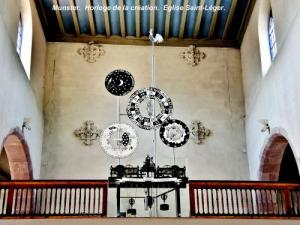 Clock of creation in the Saint-Léger church (© J.E)