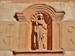 Statue of Saint Odile above the entrance porch (© J.E)