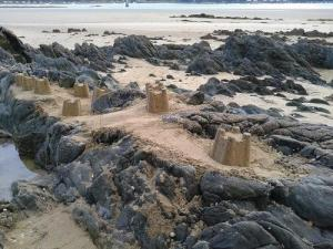 Sandcastles on the beach of Roche Silver