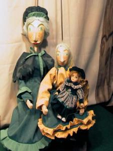 Cosette, her mom and her doll, rod puppets