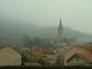 The steeple of the village caught in the mist