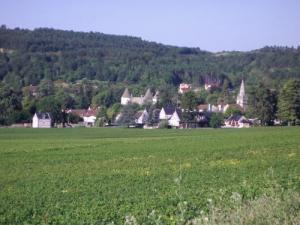 The village overview with castle and church