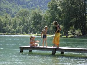 The water and children playing on the dock