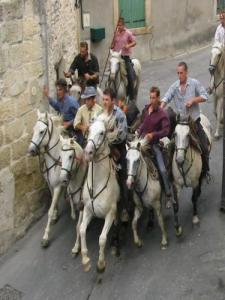 Cowboys, horses and bulls in the streets in celebration
