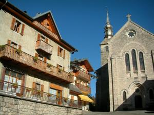 Abondance - Houses of the village (ski resort) and the Notre-Dame-d'Abondance abbey church in Haut-Chablais