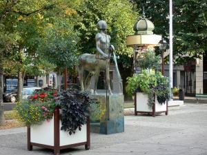 Agen - Cathedral square: centaur statue, flowers and trees