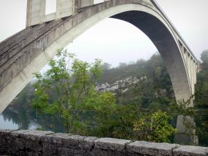 Ain gorges - Arch of the Serrières-sur-Ain bridge spanning River Ain and bank planted trees
