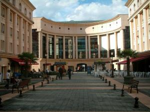 Albertville - Europe square with cafe terraces, buildings and cultural centre dome