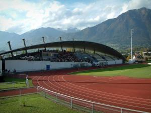 Albertville - Olympic stadium with its stands, mountains in background