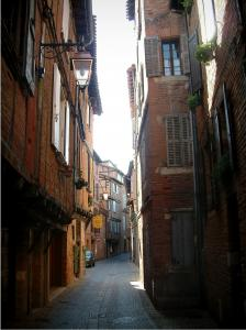 Albi - Paved street lined with old brick-built houses and timber framings