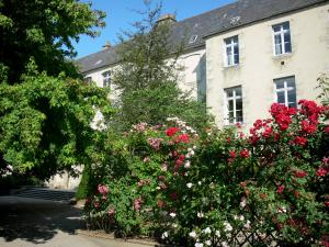Alençon - Old Jesuit college home to the Museum of Fine Arts and Lace, and blooming rosebushes