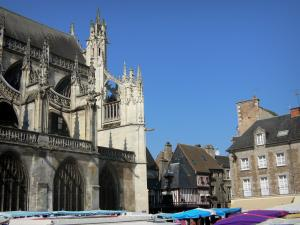 Alençon - Notre-Dame church and its porch of Flamboyant Gothic style, facades of houses in the old town