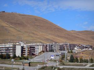 L'Alpe d'Huez - Winter and summer sports resort (ski resort): buildings and ski lifts of the ski area in the autumn
