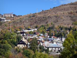 L'Alpe d'Huez - Houses, chalets and buildings of the winter and summer sports resort (ski resort), trees with autumn colors