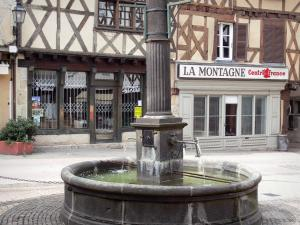 Ambert - Fountain and houses with wood sides in the old town; in the Livradois-Forez Regional Nature Park