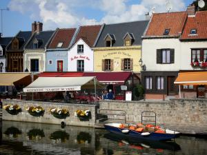 Amiens - Saint-Leu district: small houses, restaurant terrace along the water, boat on the canal