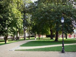 Amiens - Garden of the Bishop's palace: trees, lamppost, lawns and paths