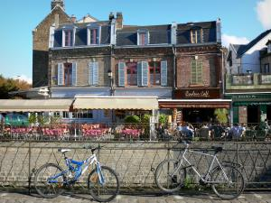 Amiens - Saint-Leu district: cycles against a rail, small houses, café and restaurant terraces on the edge of the canal