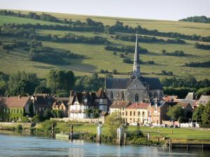 Les Andelys - Saint-Sauveur church of Gothic style and houses of Petit-Andely, river Seine and meadows