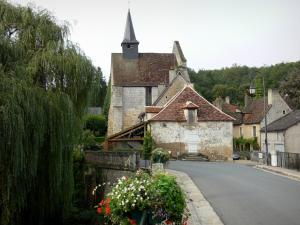 Angles-sur-l'Anglin - Saint-Croix chapel, bridge featuring flowers spanning the River Anglin, weeping willow, lamppost and houses of the village
