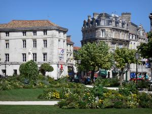 Angoulême - Flower garden (flowers, lawns) of the town hall, trees and buildings of the upper town