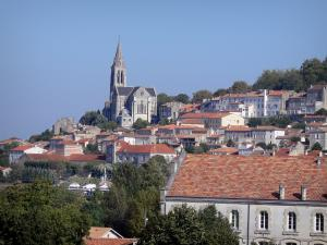 Angoulême - Bell tower of the Saint-Ausone church, trees, houses and buildings of the city