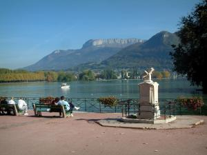 Annecy - Bank of the Europe gardens with benches and view of Lake Annecy, plane trees of the Albigny avenue and mountains