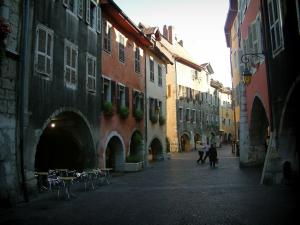 Annecy - Arcaded houses and colourful facades, café terrace and shops of the Sainte-Claire street