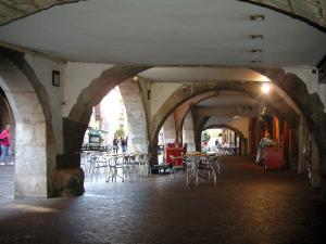 Annecy - Café terrace under the arches of the Sainte-Claire street
