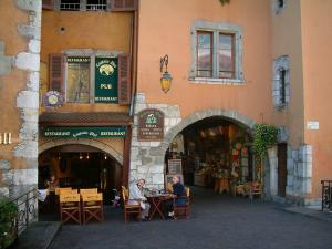 Annecy - Arcaded houses and colourful facades, a restaurant terrace and a shop