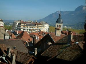 Annecy - View of the roofs of the houses of the city and mountains