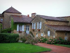 Anzy-le-Duc - Stone houses decorated with flowers; in Brionnais