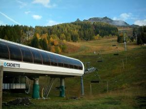 Les Arcs - Arc 1600 ski resort (winter sports) with chairlift (ski lift), trees and ski area in autumn (peripheral zone of the Vanoise national park)