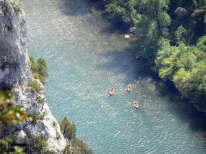 Ardèche gorges - Three canoes navigating the waters of River Ardèche