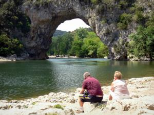 Ardèche gorges - Holidaymakers enjoying the Pont d'Arc bridge (natural arch) over River Ardèche