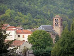 Ardes - Bell Tower of the Saint-Dizaint church and town houses surrounded by trees; in the Auvergne Volcanic Regional Nature Park