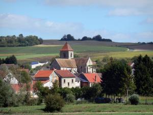 Ardre valley - Village of Crugny with its Saint-Pierre church and its houses, trees and fields