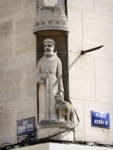Argentan - Statue of St. Anthony (patron saint of butchers) with his pig at the corner of the Rue Eugène Denis street and Place Henri IV square