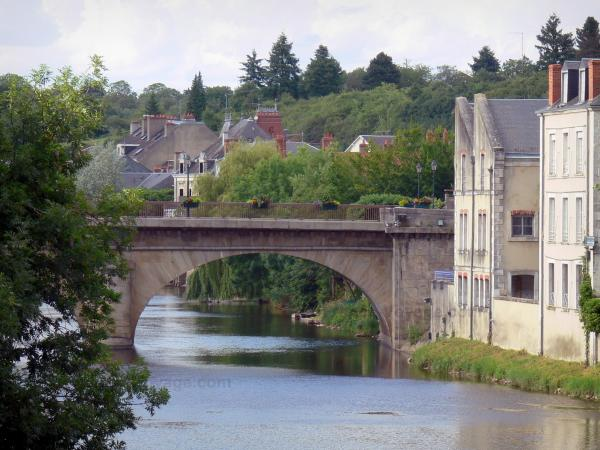Argenton-sur-Creuse - Bridge spanning River Creuse, trees and houses along the water; in the Creuse valley